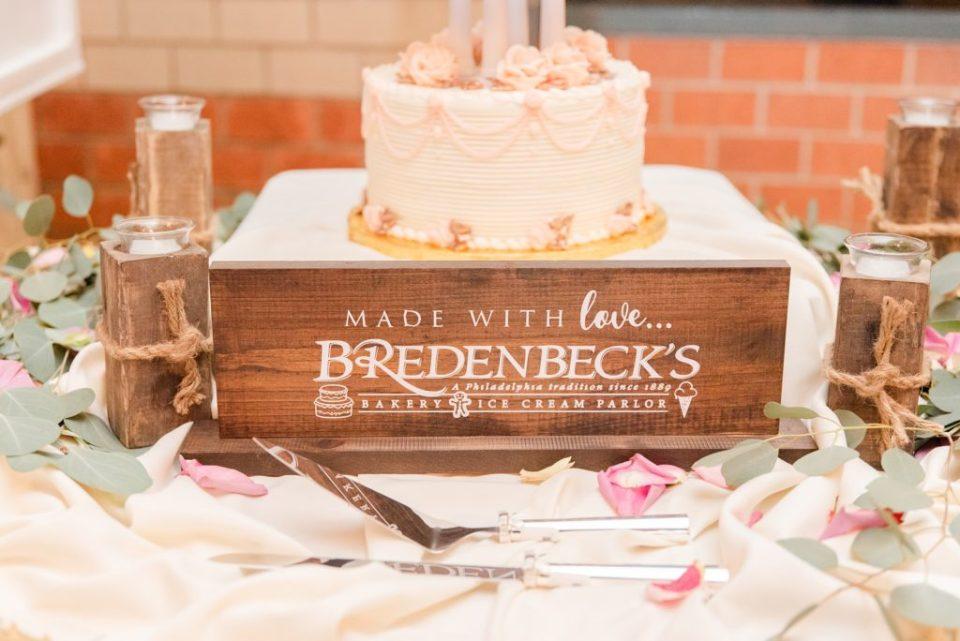 wedding cake base with Bredenbeck's Bakery sign