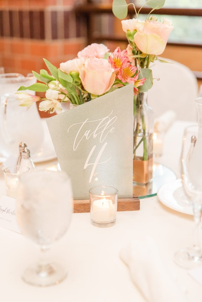 modern centerpieces with table numbers for summer wedding