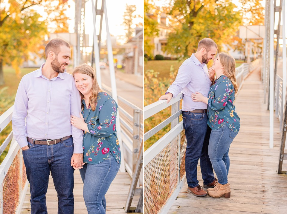 bride and groom look at each other while standing on bridge