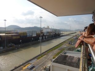 Watching a container barge passing through the Miraflores Lock