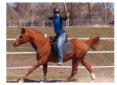 Kim doing mounted archery on Nick without a bridle