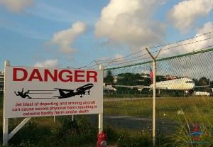 danger jets taking off sign sxm maho beach renespoints blog