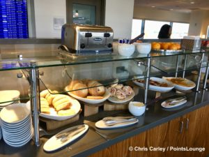 Bagels, pastries, and crepes are seen on the breakfast buffet inside The CLUB at SJC airport lounge at Norman Y. Mineta San Jose International Airport in San Jose, California.