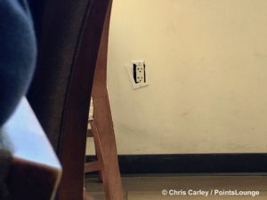 A power outlet with broken frame is seen at The CLUB at SJC airport lounge at Norman Y. Mineta San Jose International Airport in San Jose, California.