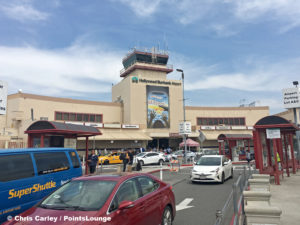 The control tower, main entrance, and terminals are seen at Burbank-Hollywood Airport - BUR - (also known as Bob Hope Airport) in Burbank, California.