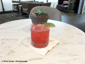 The Flower District Margarita signature cocktail drink is displayed at the Delta Sky Club Austin airport lounge at Austin-Bergstrom International Airport (AUS) in Austin, Texas. Photo © Chris Carley / PointsLounge