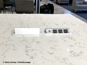 USB ports and power outlets are seen atop a high table at the United Club LAX airport lounge in Los Angeles, California.