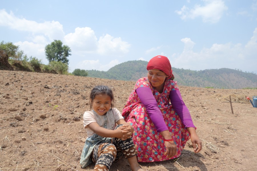 Suntali's daughter and granddaughter in their agricultural field