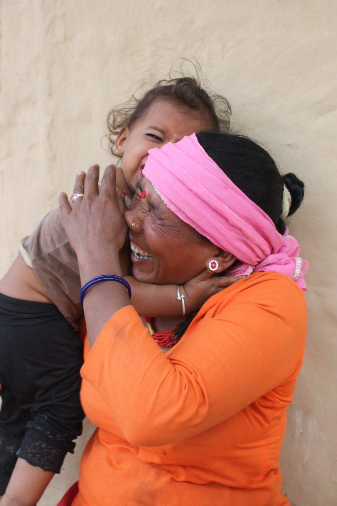 Manisara hugging her granddaughter.