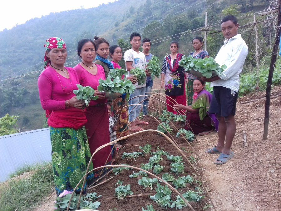 Community members in Jimi with their agricultural produce