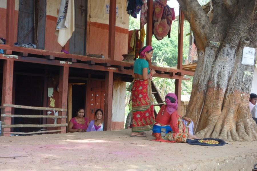 Women work in front of a building in Sanneghari