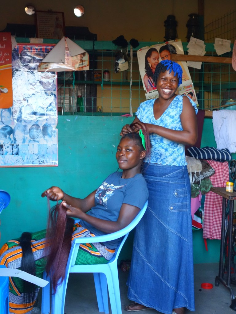 Linet at work in her hairdressing salon in Got Kachola