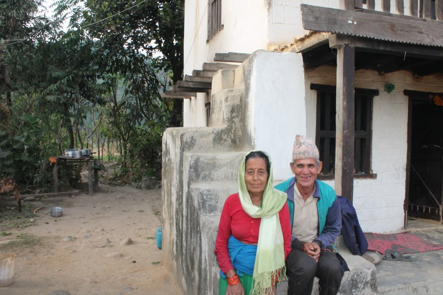 Man Bahadur and Sita Mahatra sitting outside their house