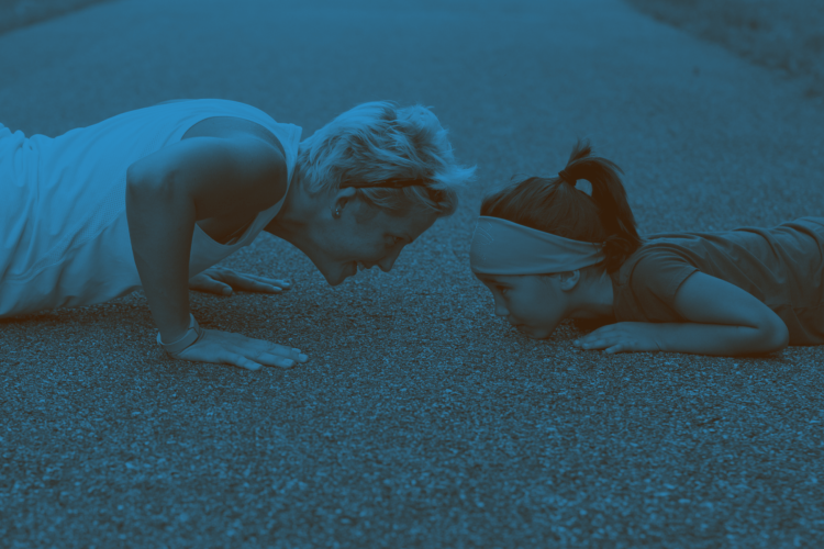 mother and daughter doing pushups