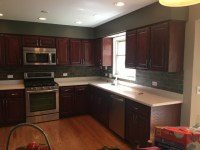Before kitchen was light oak, after refinishing it is a ...