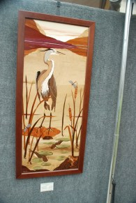 A heron is an appropriate subject for a festival along the river.