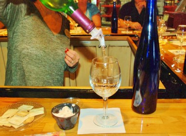 """A sample of wine is poured for each """"taster"""""""