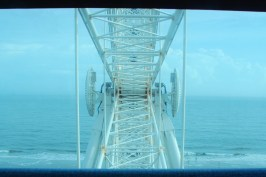 When the hub of the wheel aligns with the camera and the horizon, the car is half way up