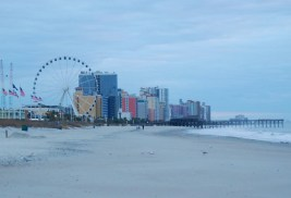 SkyWheel is visible in the distance along the beach