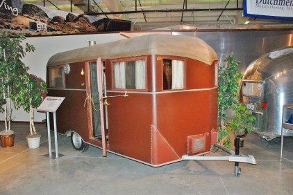 A 1931 Covered Wagon Travel Trailer. The outside is covered with leatherette and a canvas-covered roof.