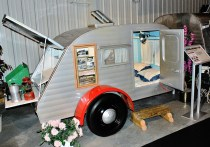 Many small modern campers use this same plan: sleeping quarters inside and a kitchen in a separate area in the back.