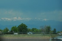 The snow-covered mountain peaks loom in the distance.
