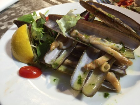 Razor clams cooked with garlic, parsley, and olive oil. This tasted heavenly!