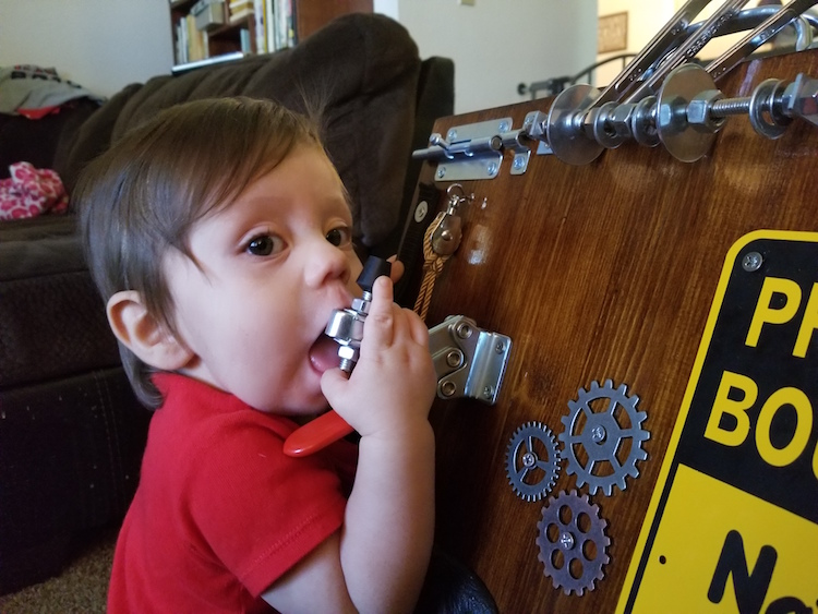 son tries out the busy board