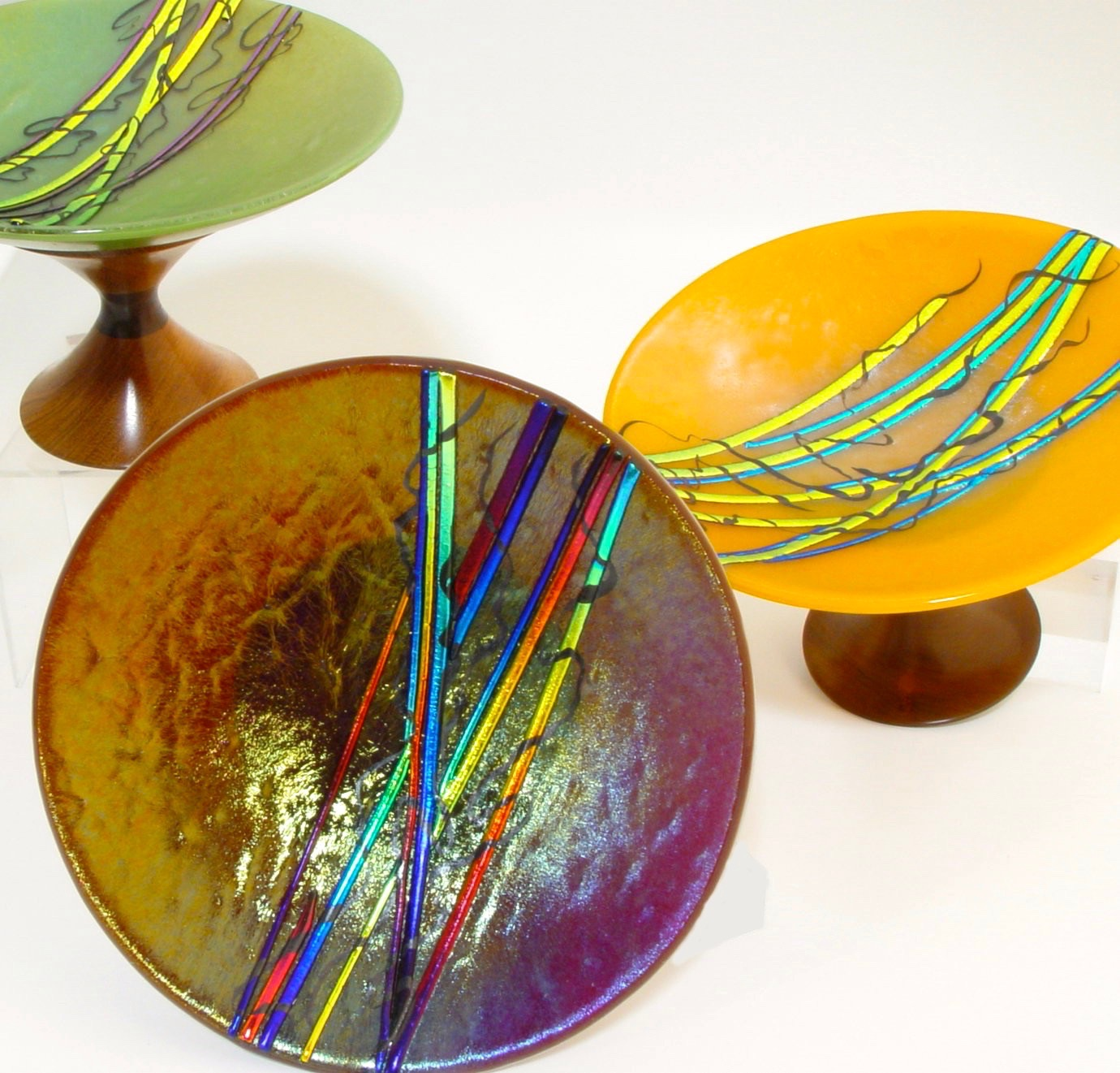 Kathleen Hallamore-Best A series of Fused bowls on turned pedistals by Joe Donohue
