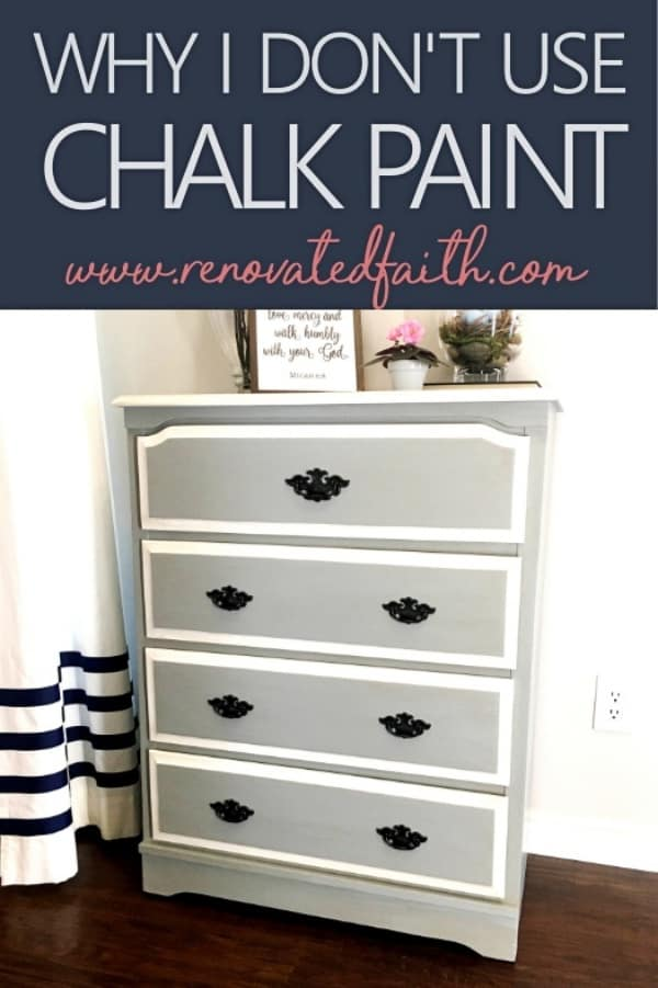 gray and white dresser with black hardware