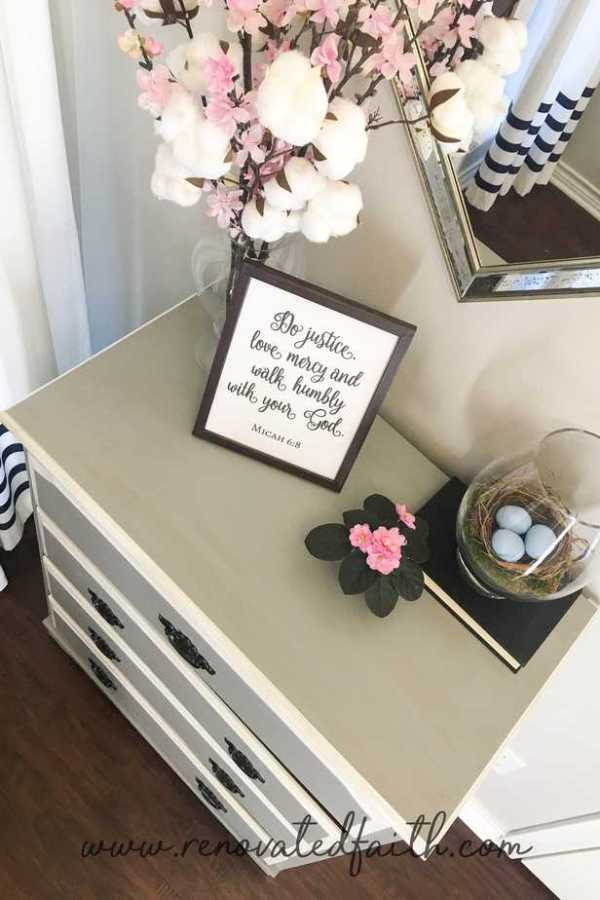 top of dresser with framed bible verse and cotton stems