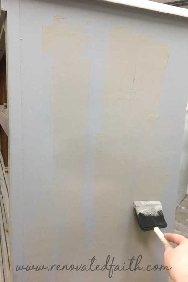 gray dresser being glazed