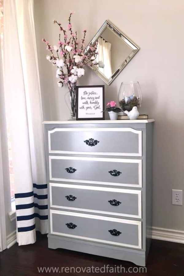 gray dresser with cotton stems