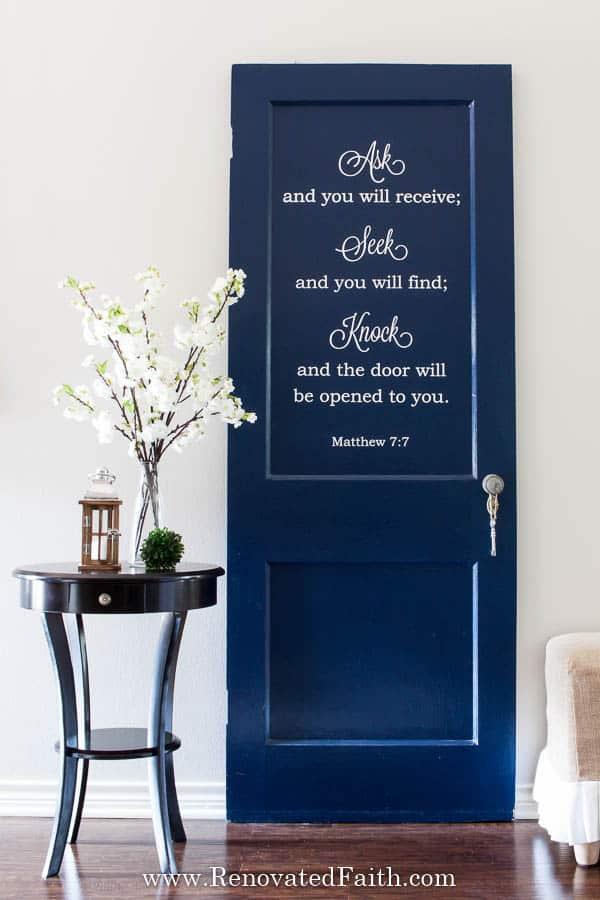 navy door with Bible verse