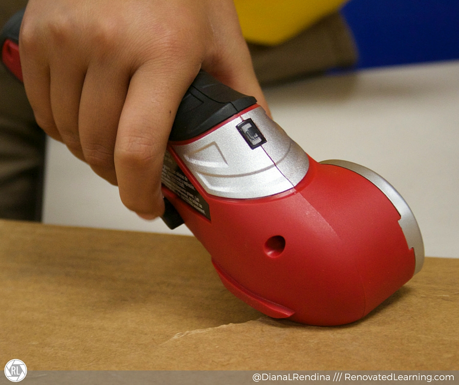An electric cardboard cutter makes it easier for students to work with cardboard and stay in the flow