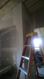 Renovating a 100 year old farm house, sheetrocking, drywalling and taping all the live long day.