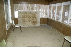 The screened in porch and an ancient matress.