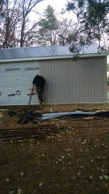 Joe working on the garage - this new siding is a snap!