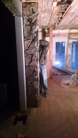 Adding rock to the chimney on the inside of our 100 year old farmhouse.