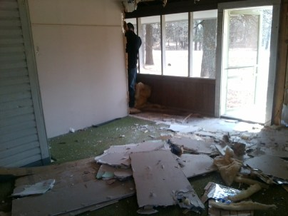 The wall between the bedroom and the screened in porch started coming down.
