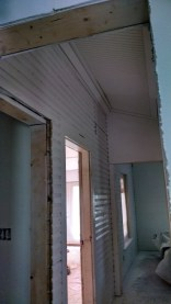 All of the old siding out in the hall looks even more spectacular now that its in white!