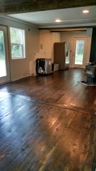 Here is the original floors in the kitchen joining the new pine floors in the entry/ding room. Together with dark walnut stain the different kinds of wood meld beautifully.