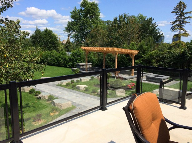 Renaissance Rail aluminum and glass railings, black, on a backyard concrete patio in Richmond Hill, ON