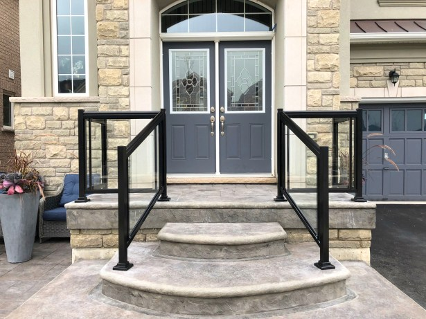 Renaissance Rail aluminum and glass railings, black, on a stamped concrete front entrance in Burlington, ON