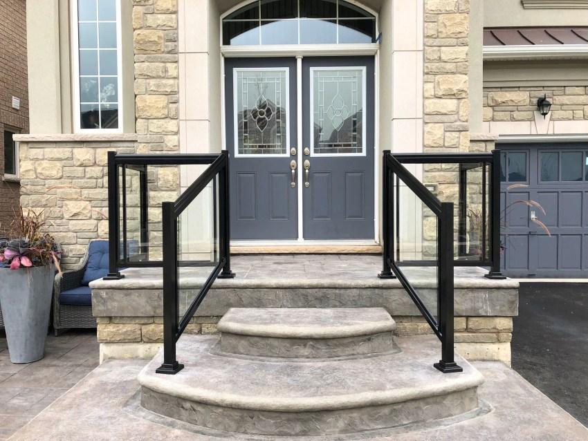 Renaissance Rail aluminum and glass railings, black, on a stamped concrete front entrance in Burlington, ON