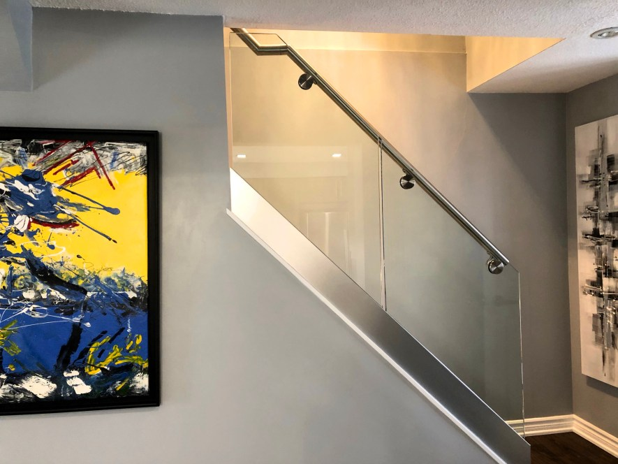 Renaissance Rail stainless steel and glass railings, base shoe, on interior stairs in Brantford, ON