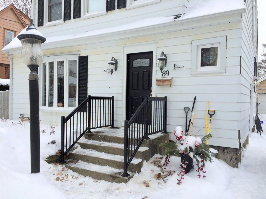 Renaissance Rail aluminum spindle railings, black, on a concrete front porch in Hamilton, ON