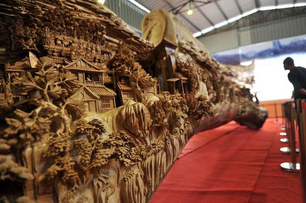 The piece won the Guinness World Record for the longest wooden carving and measures over 40ft (specifically, it is 12.286 meters long, is 3.075 meters tall at it highest point, and is also 2.401 meters wide).