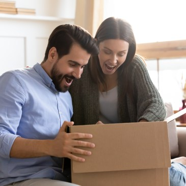 clients opening up a gift from a real estate agent