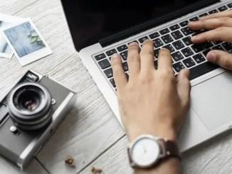 hands on a laptop key